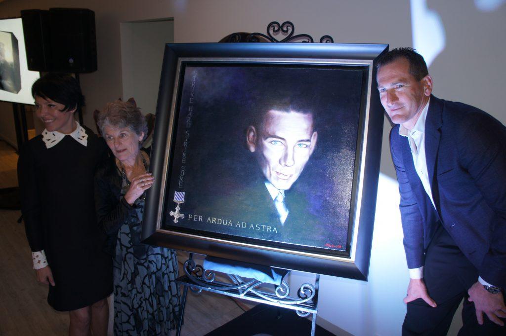 Travis Schultz and his mum, Denise, unveils an artwork of Jack O'Brien by international artist Anna Rubin to mark the launch of Travis Schultz Law.