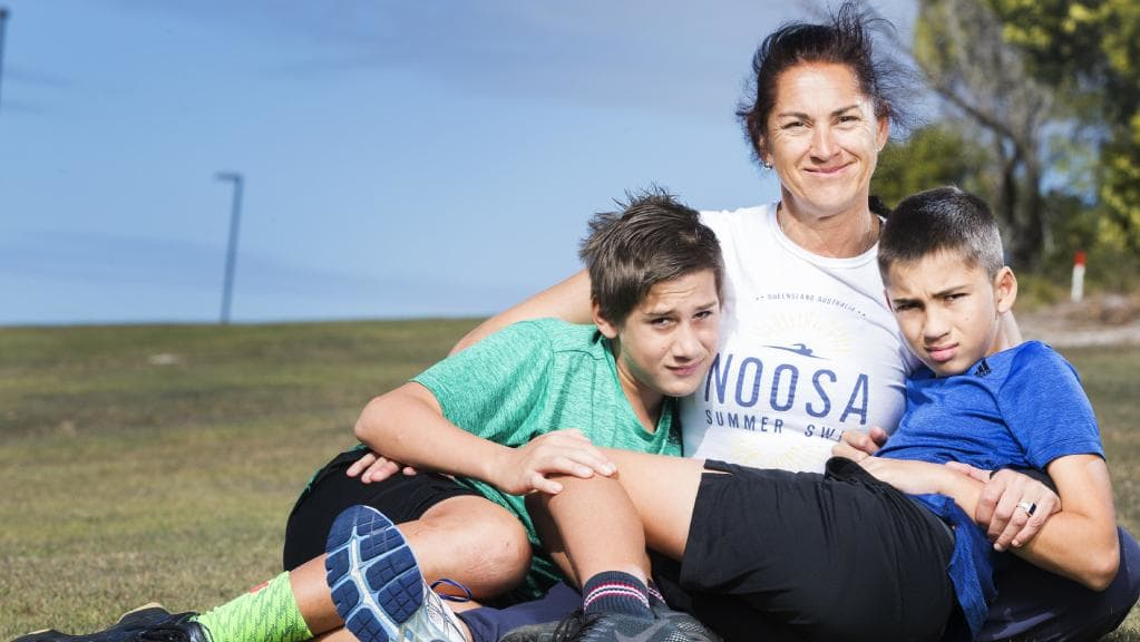 Dr Sally James, with twin sons Charlie and Oscar, 12, was injured during a triathlon.